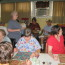 Crew plays bingo with residents at assisted living facility